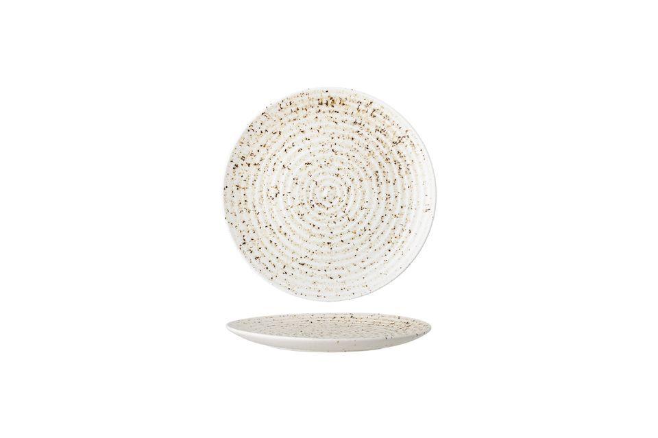 Dieser Teller aus Steingut trifft die Wahl der Farben und der nüchternen Details